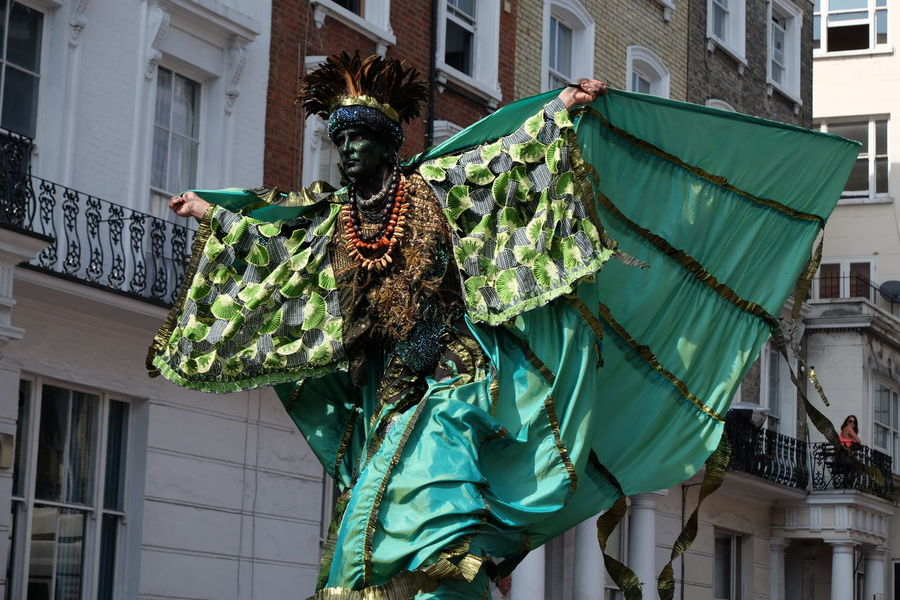 Man on Stilts, Nottinghill Carnival Carnival Composition Fun GB London Man Tourist Attraction  Unusual Capital City Carnival Costume Cloak Full Frame Full Length Green And Black Colour Headress Low Angle View Man On Stilts No Incidental People Nottinghill Carnival Outdoor Photography Scarecrow Tarvel Destination Uk Walking On Stilts