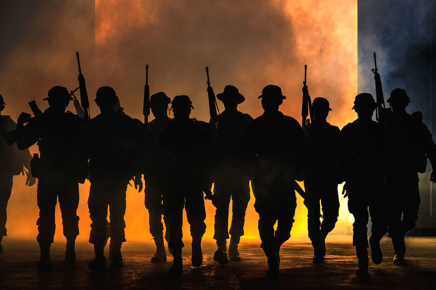 Teamwork Full Length Group Of People Gun Control Large Group Of People Lifestyles Men Orange Color Real People Silhouette Smoke - Physical Structure Soldiers Uniform Standing Togetherness
