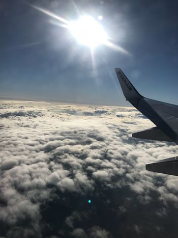 Cominghome Airplane Sky Sun Journey Nature Lens Flare Cloud - Sky Beauty In Nature Transportation Aerial View Airplane Wing Sunbeam Sunlight Air Vehicle Travel Flying Scenics No People Tranquility Outdoors