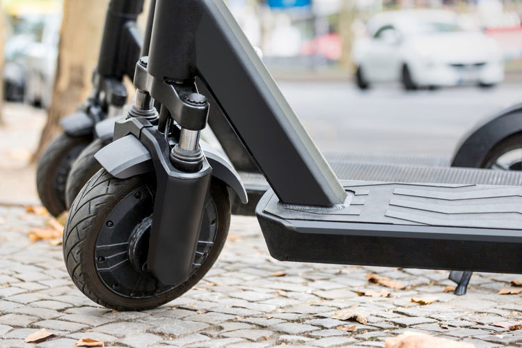 Close-up of electric push scooter on street