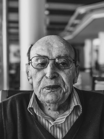 Portait photo of my grandfather 2 weeks after receiving his second pfizer jab. he missed his family.