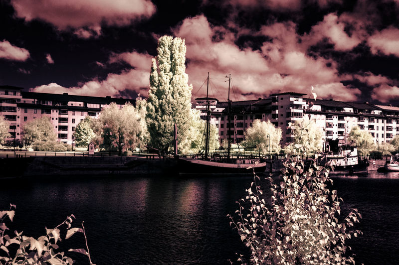 Stockholm Dockside [IR]. Alternative edit here: https://www.instagram.com/p/BcGLnmhBEC6/ Architecture Beautiful Check This Out Exceptional Photographs EyeEm Best Shots Hanging Out Hello World Nature Relaxing Taking Photos Tree Beauty In Nature Cloud - Sky Day Enjoying Life Eye4photography  Building Exterior Landscape Light And Shadow No People Outdoors People Sky Skyporn Water