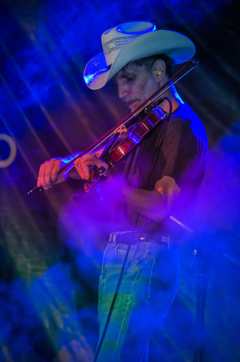 Cowboy Night Party at Nakhonsawan City, Thailand Cowboy Smoke Summer In The City The Maverick Arts Culture And Entertainment Concert Country Music Hat Music Musician Nightlife One Person Showing Skill  Stage Violinist คาวบอย นักไวโอลิน เพลงคันทรี่ カントリーミュージック バイオリニスト 小提琴手 音樂會