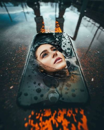 Portrait of a beautiful young woman in rain