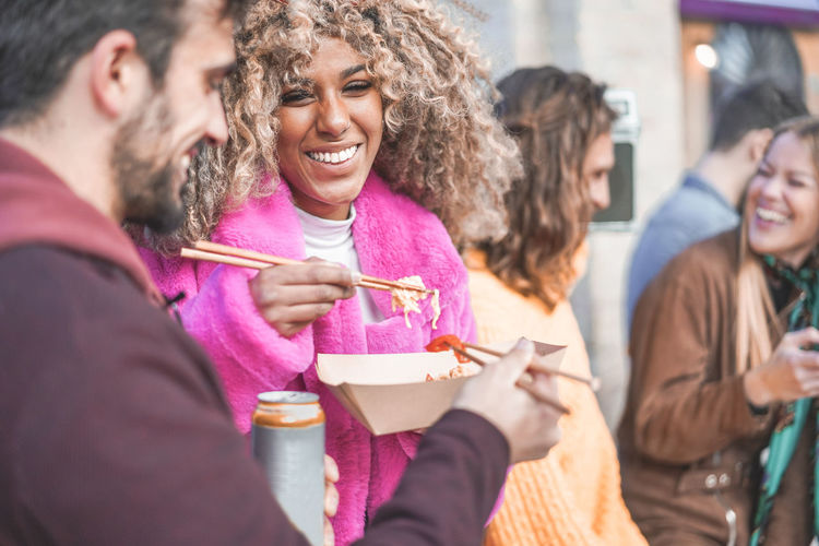 Multiracial friends eating street foot outdoor Group Of People Happiness Smiling Men Emotion Enjoyment Cheerful Young Adult Food And Drink Friendship Togetherness Fun Women Drinking Party Millennials Street Food