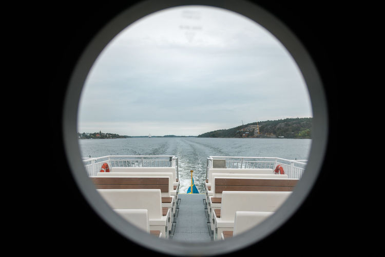 Commuting in the stockholm archipelago Archipelago Commuting Architecture Boat Boats Built Structure Circle Cloud - Sky Day Geometric Shape Glass - Material Indoors  Mode Of Transportation Nature Nautical Nautical Theme Nautical Vessel No People Shape Sky Transparent Transportation Travel Water Window