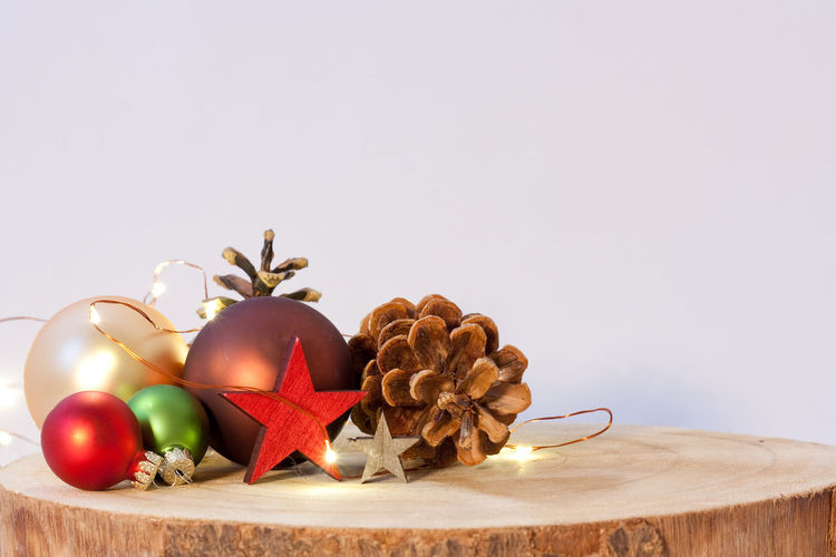 Gold Colored Red Color Wooden Celebration Christmas Lighting Equipment Backgrounds Merry Christmas! Christmas Lights Pine Cone Stars No People Copy Space Food Food And Drink Spice Studio Shot Christmas Ornament Decoration Indoors  Holiday Christmas Decoration Still Life Holidays
