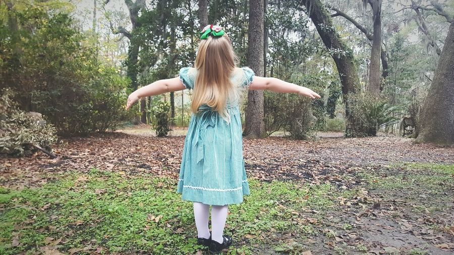 Child Girls One Girl Only Carefree Long Hair Childhood Blond Hair Rear View Full Length Freedom People Outdoors Grass Nature Children Only Fun Day Naturelover EyEmNewHere Forestwalk Playing Arms Outstretched Flying Flowers,Plants & Garden Little Girl EyeEmNewHere