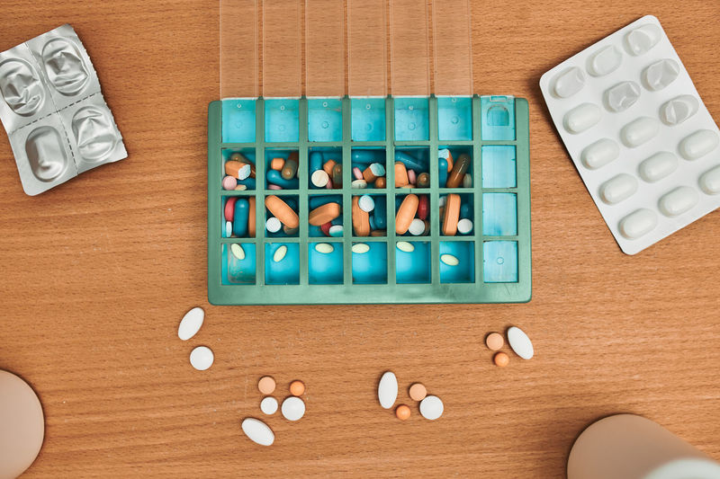 Pill dispenser. healthcare and old age concept with medicines. medicaments on table