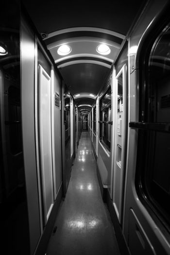 EyeEm Selects EyeEmNewHere Blackandwhite Black And White Friday No People Corridor Indoors  The Way Forward Subway Train Illuminated Night Train An Eye For Travel The Graphic City
