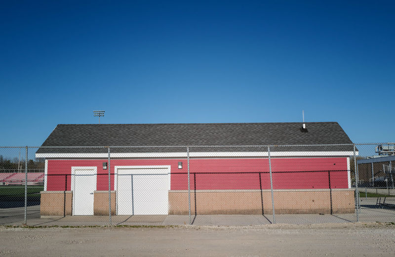 Closed red stadium storage shed