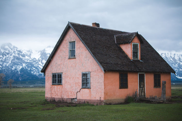 Alone in Yellowstone Abandoned House Abandoned Places Mountain View Pink Abandoned Abandoned Buildings Architecture Beauty In Nature Building Exterior Built Structure Cloud - Sky Field Grass House Landscape Mountain Mountain Range Nature No People Outdoors Pink Color Scenics Sky Tranquility EyeEmNewHere