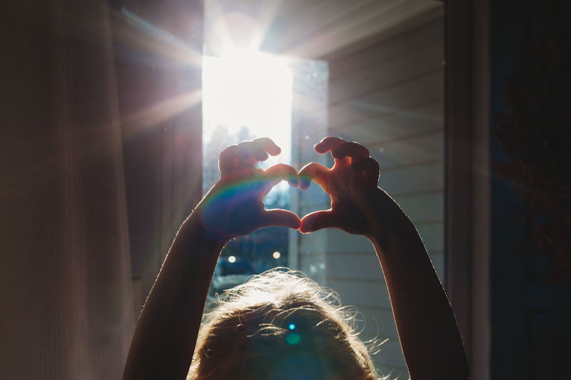 Sunlight Lens Flare One Person Real People Lifestyles Sunbeam Window Sun Hand Arms Raised Child Childhood Heart