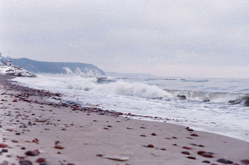 Scenic view of waves crashing at shore of beach