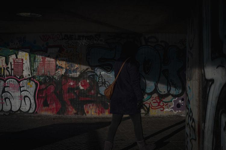 Full frame shot of graffiti on wall in city