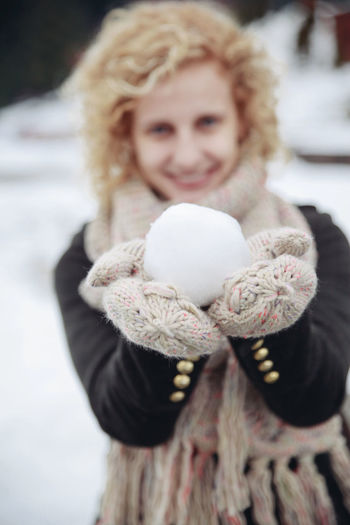 It's Cold Outside Girl Snow Ball Winter Snow Portrait Curly Hair Holding Hands Front View Smile Women Who Inspire You The Portraitist - 2016 EyeEm Awards Natural Light Portrait People And Places Connected By Travel Shades Of Winter