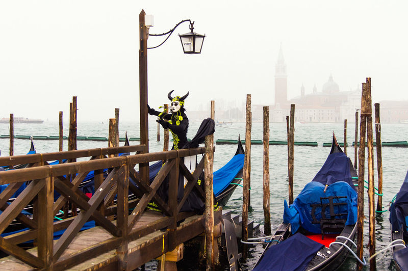 Carnival in Venice Canal Grande Carnival In Venice Venice, Italy Architecture Built Structure Costume Day Disguised Gondola - Traditional Boat Mask Nautical Vessel Outdoors Pose Transportation Travel Destinations Water Wooden Post