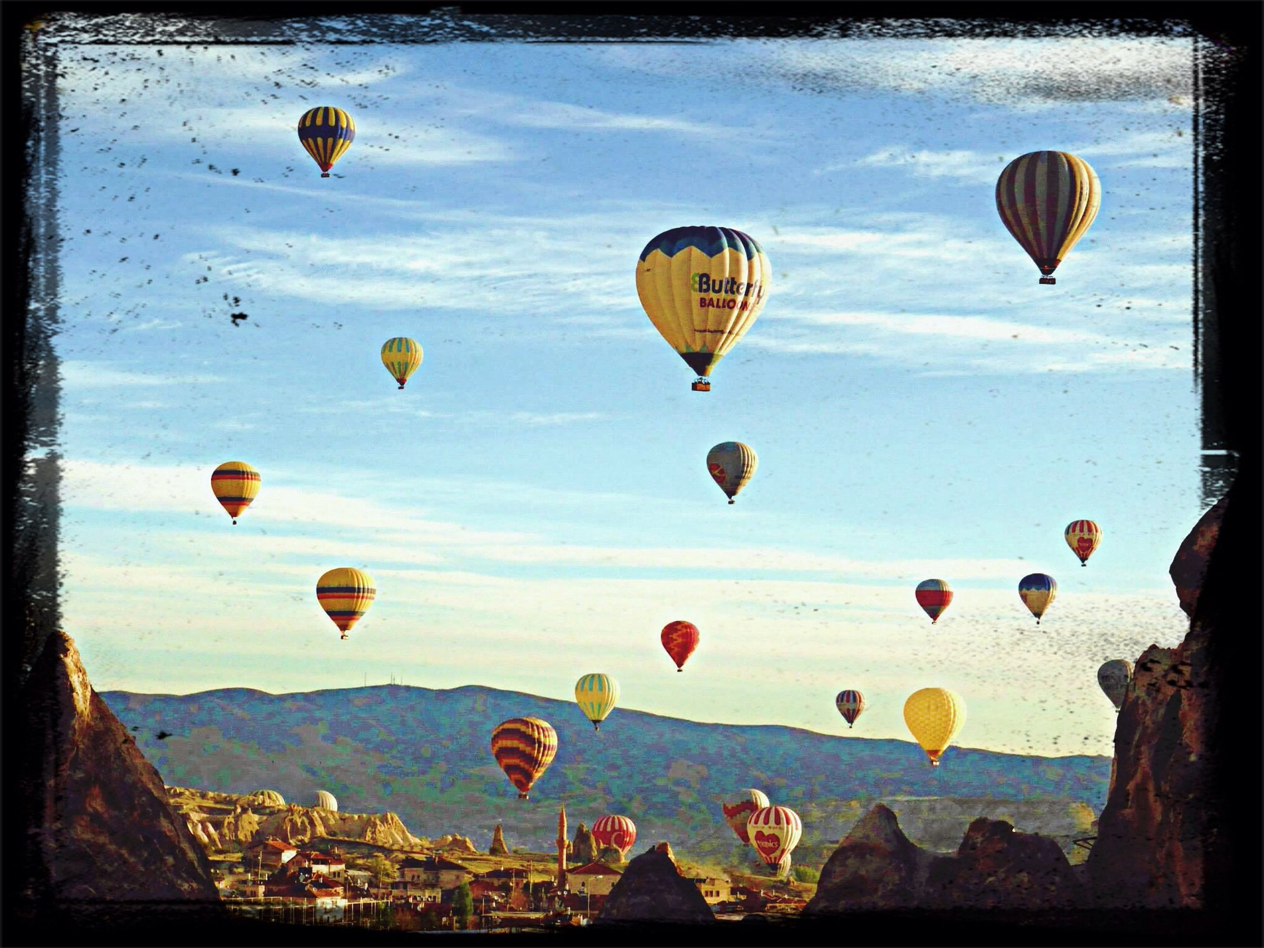 transfer print, flying, mid-air, auto post production filter, sky, multi colored, hot air balloon, sea, parachute, water, leisure activity, blue, adventure, paragliding, vacations, outdoors, sport, nature, transportation, scenics
