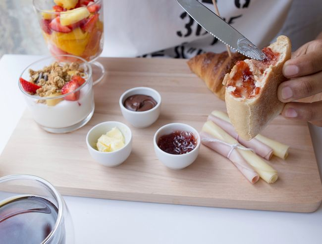 Food And Drink Fruit Healthy Eating Indoors  Food Freshness Breakfast Sweet Food People Day Ready-to-eat Close-up Breakfast Brunch White Background Bread Eating Half Eaten Croissant Human Body Part Plate Human Hand White Color Freshness Jam