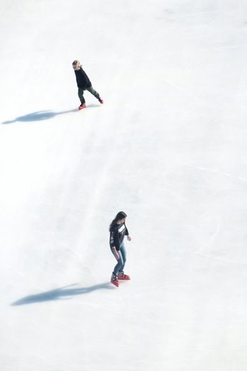 High angle view of people ice-skating on rink
