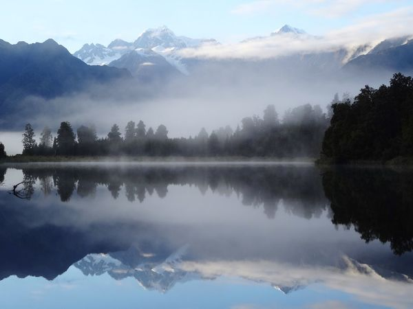 Reflection Mountain Water Nature Lake Tranquility Beauty In Nature Perspectives On Nature No People Sky Mountain Range Fog Tranquil Scene Outdoors Day Tree Water Reflections Silence Symmetry Morning Light Lake Matheson Mirror Lake New Zealand Calm Foggy