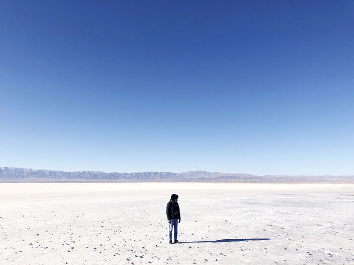 Clear Sky Sky Copy Space Scenics - Nature Beauty In Nature Blue Real People Nature Day Lifestyles Rear View Environment Leisure Activity Land Non-urban Scene Landscape Tranquility Full Length Tranquil Scene Standing Salt Flat Outdoors Arid Climate Climate My Best Photo