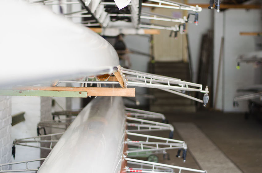 Boating Canoe Canoeing Rowing Rowing Boat Adventure Boat Boats Business Day Equipment Focus On Foreground Garage Indoors  Industry Railing Rowing Boats Selective Focus Technology White Color