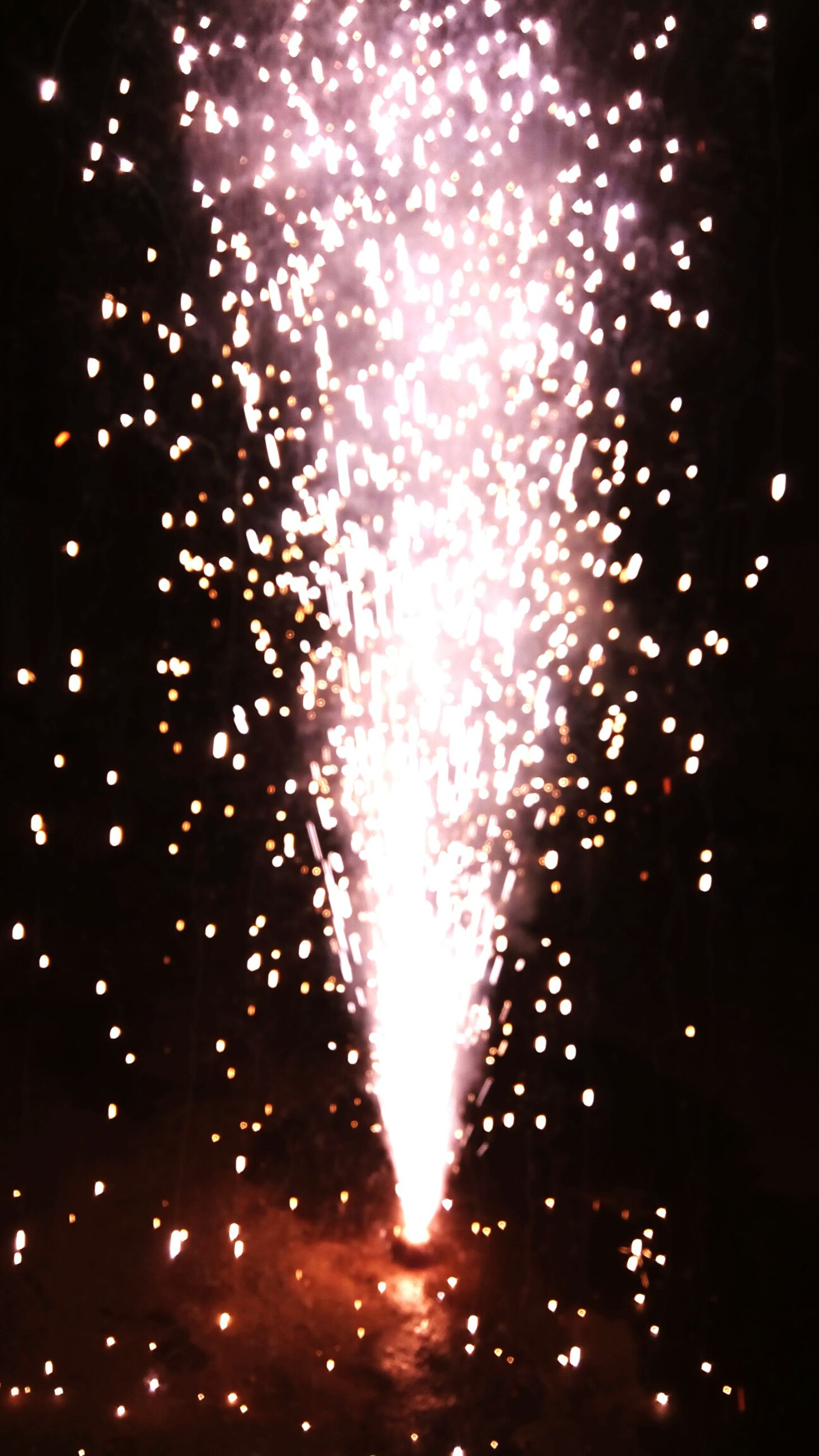 night, illuminated, firework display, celebration, glowing, low angle view, long exposure, firework - man made object, exploding, sparks, motion, firework, arts culture and entertainment, light, lighting equipment, sky, blurred motion, event, celebration event, light - natural phenomenon