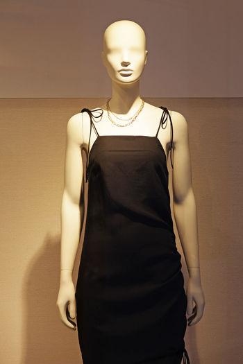 Midsection of mannequin in store