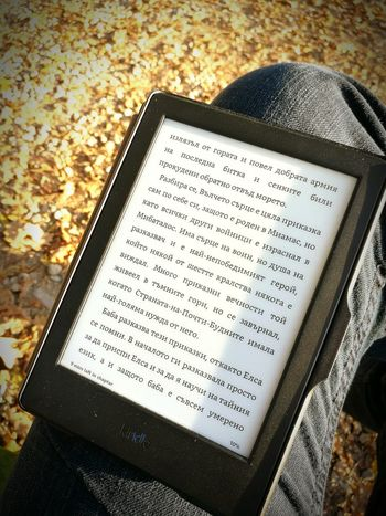 Reading means traveling free of charge Reading Autumn Outdoors Book E-book E-book Reader Kindle Cyrillic Text Close-up