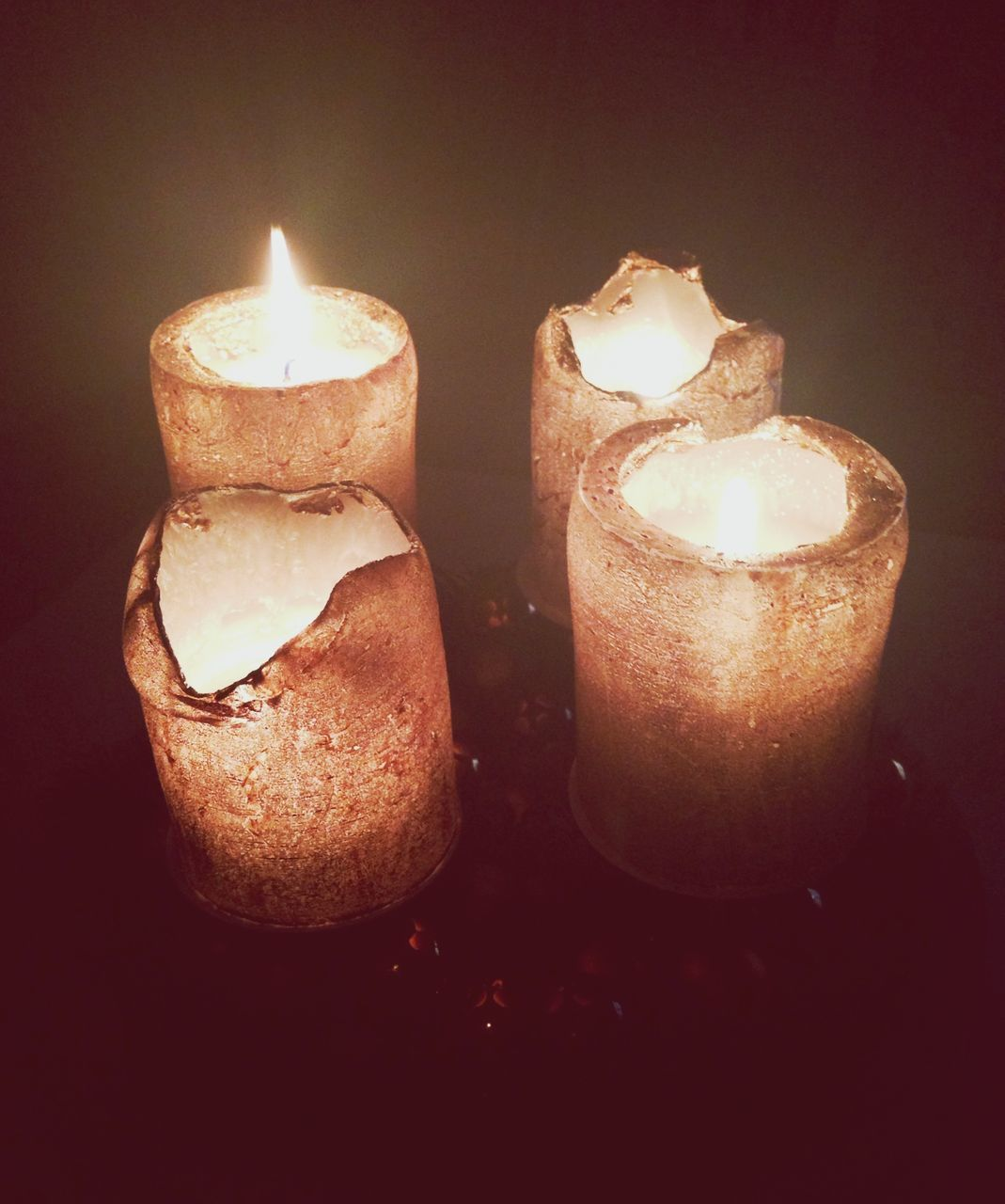 Close-up of burning candle in dark