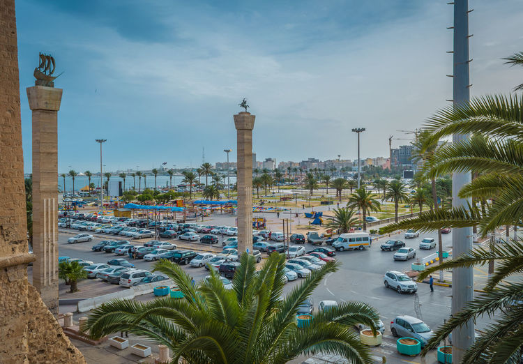 Architecture City Cityscape Day High Angle View Libya Tripoli Martyr Square Outdoors Palm Tree Sea Sky Tourism Traffic Circle Travel Travel Destinations Tree Tripoli Urban Skyline Vacations