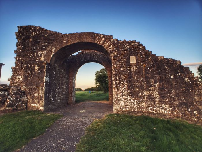 Ancient Civilization Arch Architecture Built Structure Clear Sky Day Grass Historical Building History Ireland Irish Low Angle View No People Old Ruin Outdoors Sky The Past Tomb Travel Travel Destinations War War Memorial
