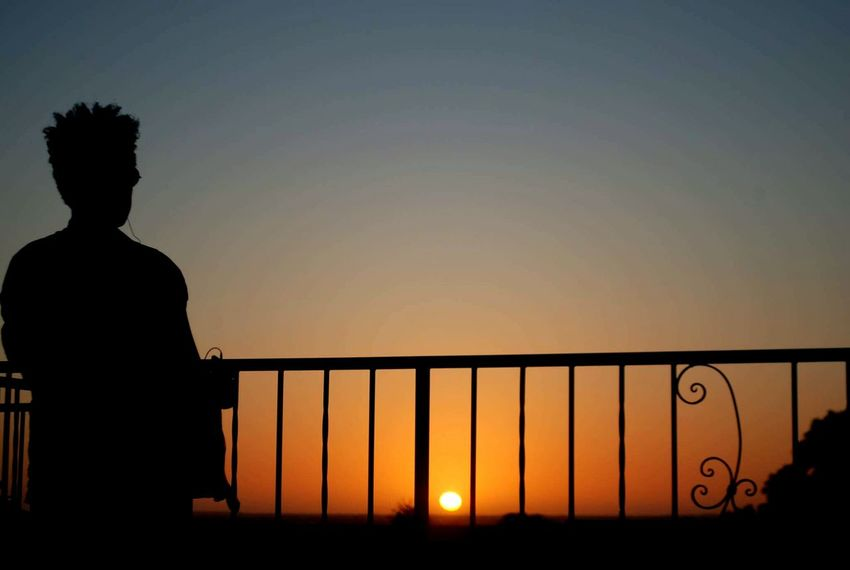 Sunset One Person Rear View Silhouette Adults Only Railing Standing Clear Sky Young Adult Only Men Sky Cityscape EyeEm The Best Shots Fresh on Market 2016 Makeup Art Built Structure Eyeemphotography Eyem Gallery Ayeem! What's Up ??  First Eyeem Photo Popular Photos Adventure Sunset Lovers Outdoors Nature