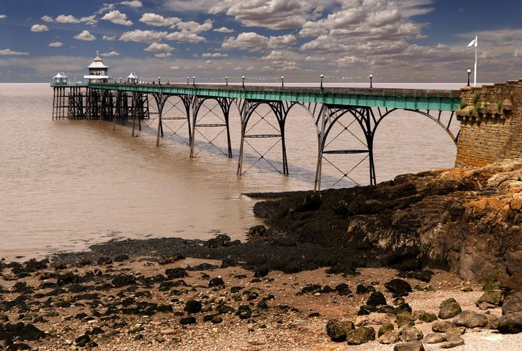 The Victorian pier at Clevedon, Somerset, England. The pier opened in 1869 as a ferry port to South Wales Historical Building Tourist Attraction  Travel Photography Victorian Arch Pier Architecture Beach Bridge - Man Made Structure Built Structure Cloud - Sky Connection Day Land Nature No People Outdoors Pier Scenics - Nature Sea Sky Tranquility Transportation Travel Destination Victorian Architecture Water