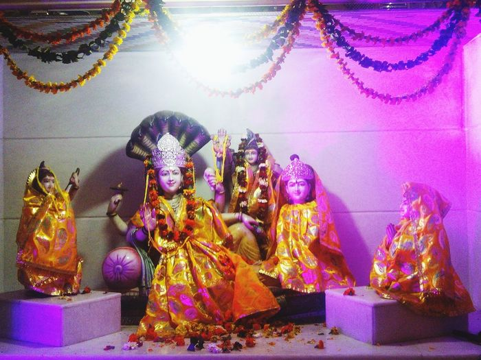 MahaShivRatri Temple Indoors  Inside The Temple Decorations Decorated Deities Lord Vishnu Goddess Lakshmi Bestower Of Wealth Prosperity Success Victory at Prachin Shiv Mandir sector8, Chandigarh..it is said that God actually means G for Generator Lord Brahmacreator of the universe,bestows wisdom,his wife- Goddess Saraswatibestows knowledge,O for Operator-Lord Vishnuwho along with his wife Goddess Lakshmi make sure of balanced working of d world&finally D for Destroyer-Lord ShivaHe's believed to be the Final Visitor Death So,d balance G.O.D.