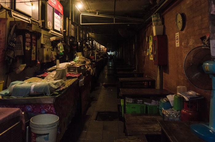 closing time of vegetable market at night in bangkok, thailand Absence At Night Bangkok Thailand Close Closing Time Crate Diminishing Perspective Empty Empty Bin Fan Gas Tank Hazy  Illuminated Interior Lighting Equipment Narrow No People Retail  Store Table The Way Forward Vegetable Market Walkway