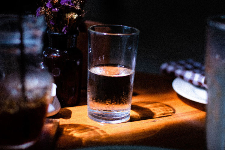 Coffee Drink Refreshment Alcohol Glass Food And Drink Table Household Equipment Drinking Glass Indoors  Beer Beer - Alcohol Freshness Still Life Bar - Drink Establishment Close-up No People Beer Glass Selective Focus Restaurant Transparent Bar Counter Froth