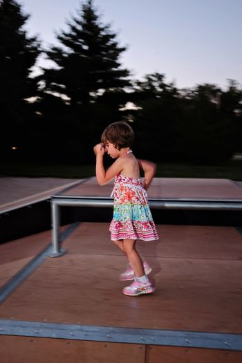 Side View Of Girl On Ramp At Skateboard Park During Sunset