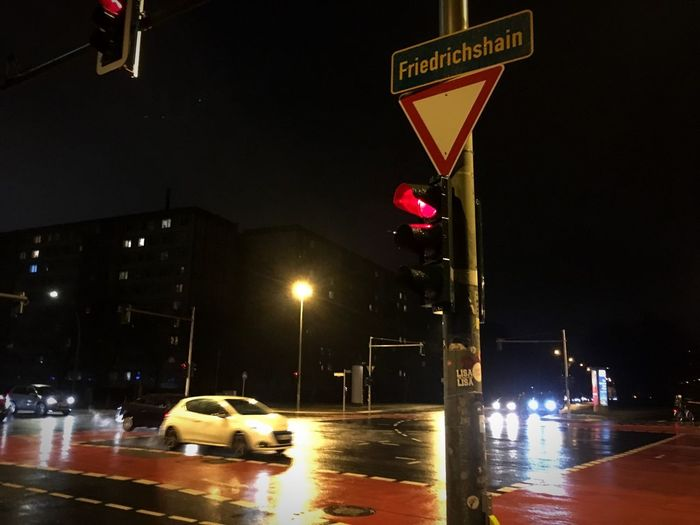 End of Friedrichshain Reflections Car Night Motor Vehicle Transportation Sign Illuminated City Road Mode Of Transportation Street Street Light City Life No People Stoplight