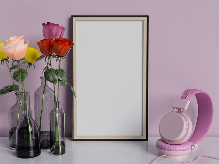 Frame mock up on table with rose flowers. Flower Flowering Plant Plant Beauty In Nature Pink Color Indoors  Freshness No People Fragility Vulnerability  Close-up Vase Nature Purple Still Life Petal Table Decoration Wall - Building Feature Flower Head Flower Arrangement Rosé