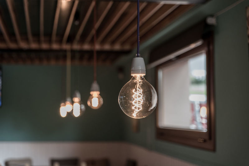 Bokeh Business Business Finance And Industry Day Hanging Illuminated Indoors  Light Bulb Lighting Equipment Luxury Modern No People Pendant Light Perspective Store Vintage Vintage Light Bulb Vintage Lights