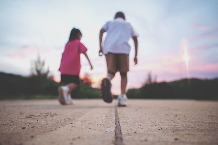 Running out Two People Full Length Togetherness Rear View Real People Women Sky Leisure Activity Bonding Lifestyles Family Nature Child Casual Clothing Girls Sunset People Friendship Adult Men EyeEmNewHere