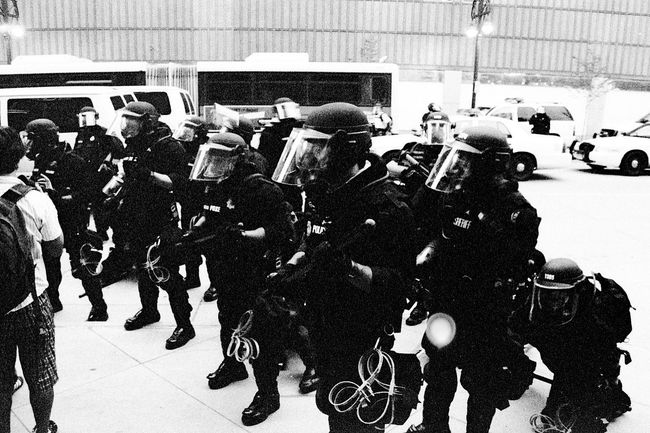 Protests at the 2008 Democratic National Convention (DNC) 2008 Democratic National Convention Black & White Film Protest Adult Black And White Black And White Photography Blackandwhite Blackandwhite Photography Civil Disturbance Crowd Day Film Photography Full Length Land Vehicle Large Group Of People Men Mode Of Transport Outdoors People Protesters Real People Transportation Tri-x 400 Pushed Women