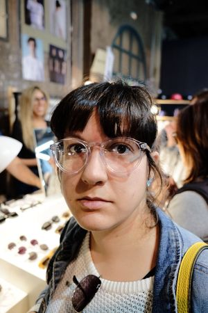 Love the OO! // Sooc Fujifilm_xseries Real People Incidental People Focus On Foreground Fashion One Person Eyeglasses  Small Business Indoors  Headshot Skill  Young Adult Day Young Women Occupation Women Portrait Close-up People The Week On EyeEm Barcelona Glasses