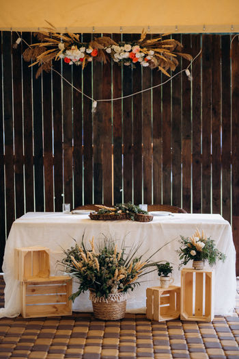 View of decoration on table against wooden wall
