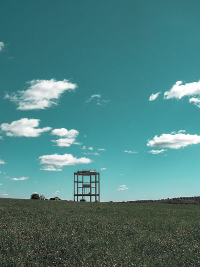 unfinished building among the fields Tower Unfinished Clover Clover Flower Unfinished Building Clover Field Abandoned Sceleton Russia Fluffy Clouds Summer Crop  Sky Cloud - Sky Countryside Tranquil Scene Tranquility Scenics Lookout Tower Idyllic Calm Growing