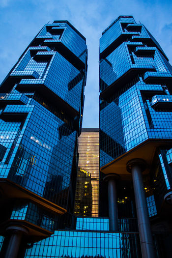 Architectural Feature Architecture Blue Building Exterior Capital Cities  City Financial District  Giants Glass - Material Low Angle View Modern No People Office Building Outdoors Sky Skyscraper Tall - High Tower Urban Skyline Urban Geometry Urban Collection Geometric Shapes