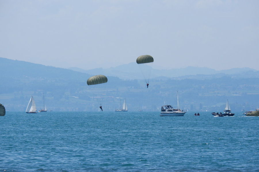 Bodensee Boats⛵️ Parachute Paratrooper Paratroopers Water Parachute Sea Flying Mid-air Extreme Sports Sky Boat The Photojournalist - 2018 EyeEm Awards