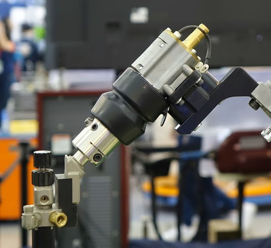 Mechanical arm of an industrial robot automation tool Technology Equipment Industry Engineering Industrial Robot Automation Manufacturing Equipment Industrial Tool Machinery Manufacturing Factory Electronics Industry Robot Arm